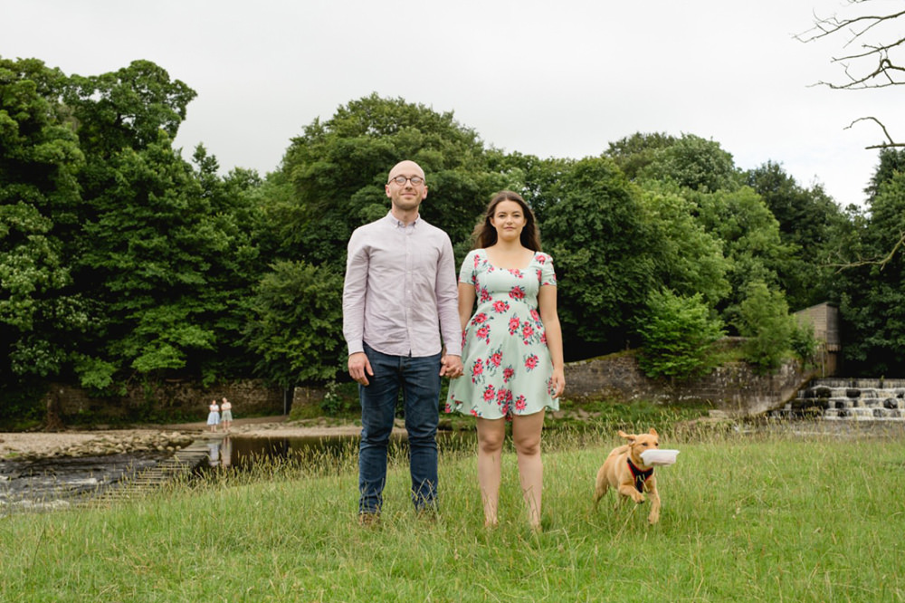 fun couple portrait with naughty dog as a pre wedding session in ilkely