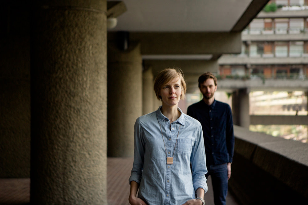 photo of cool couple in the barbican midcentury building london