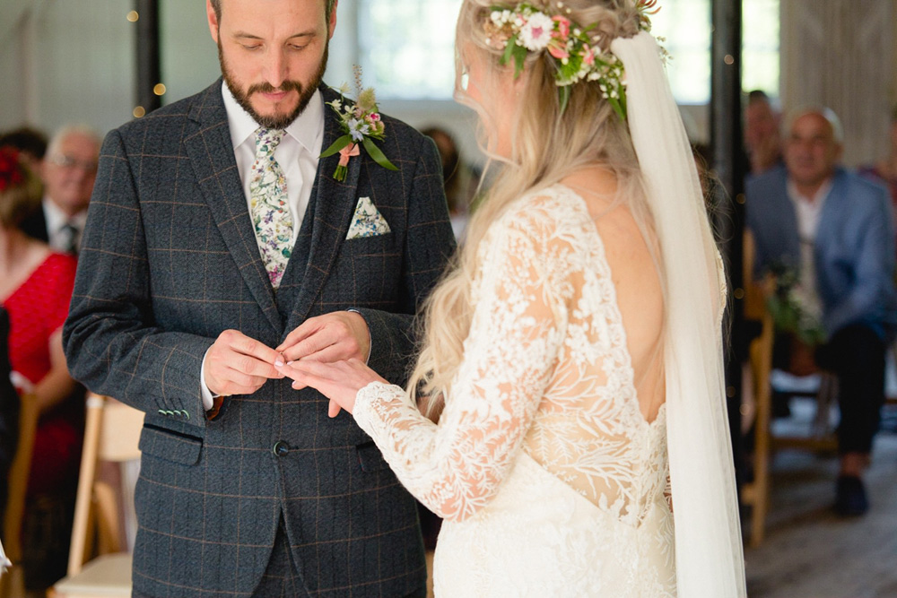 exchange of rings inside Gibson Mill wedding venue hebden bridge