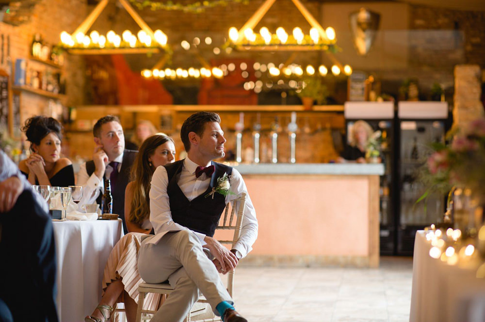 guests sat during speeches at Barn wedding reception
