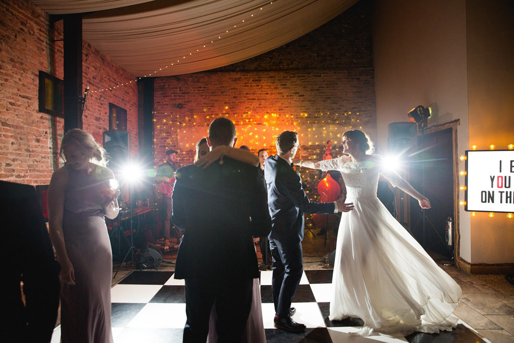 bride and groom during the first dance with band at hornington manor