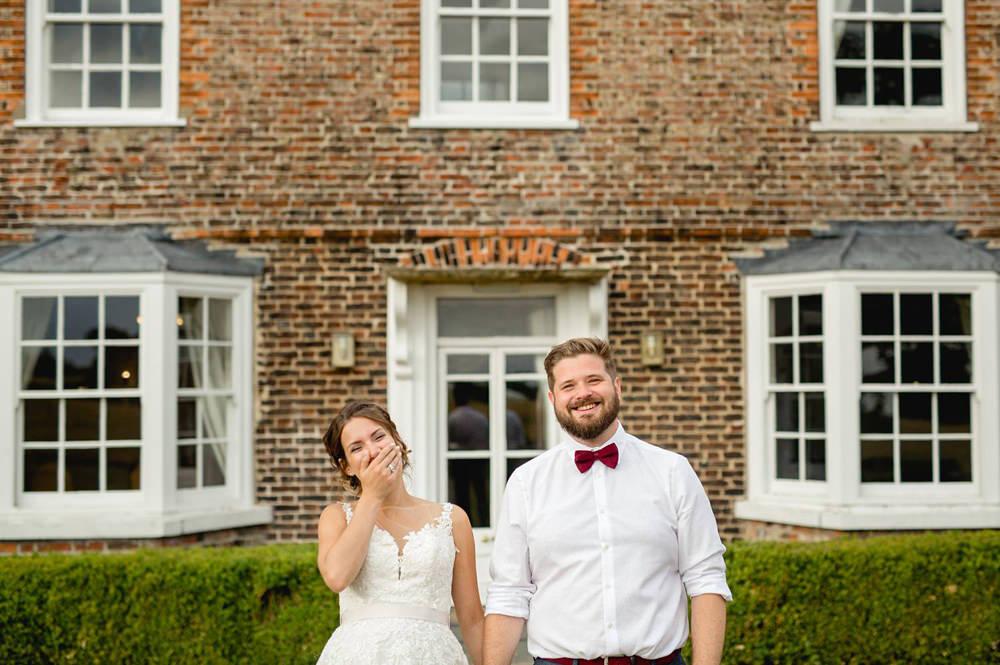 fun portrait of couple outside of Hornington Manor