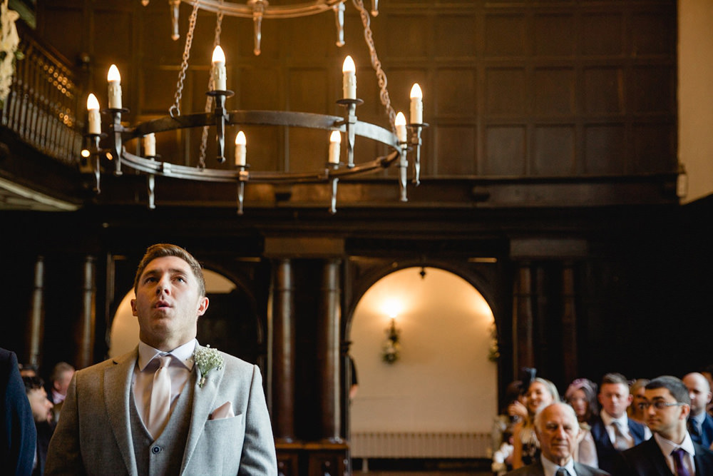 documentary photo of groom waiting for bride in oakwell hall