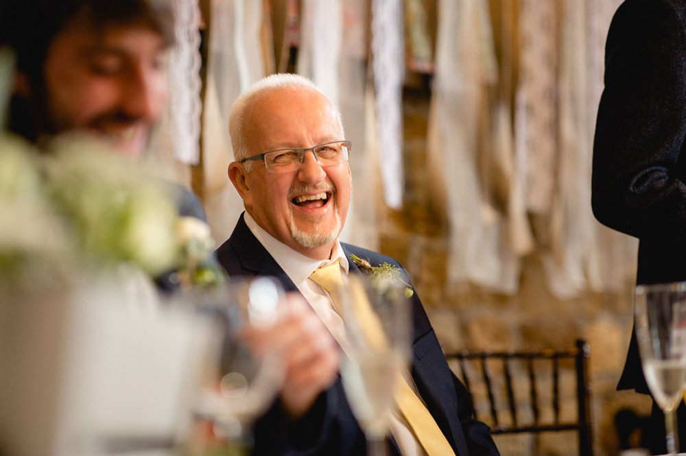 Natural moments during speeches at oakwell hall barn wedding venue