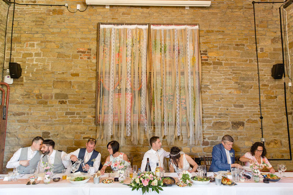 creative wedding photo of the top table at Oakwell Hall Barn