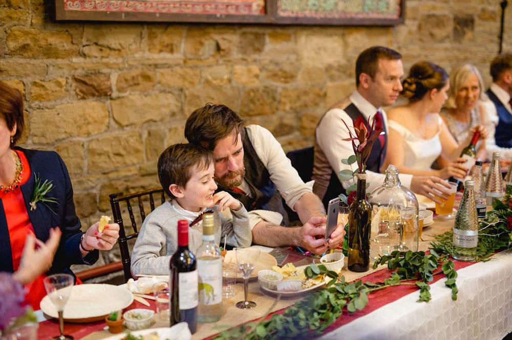 natural moments during barn wedding reception