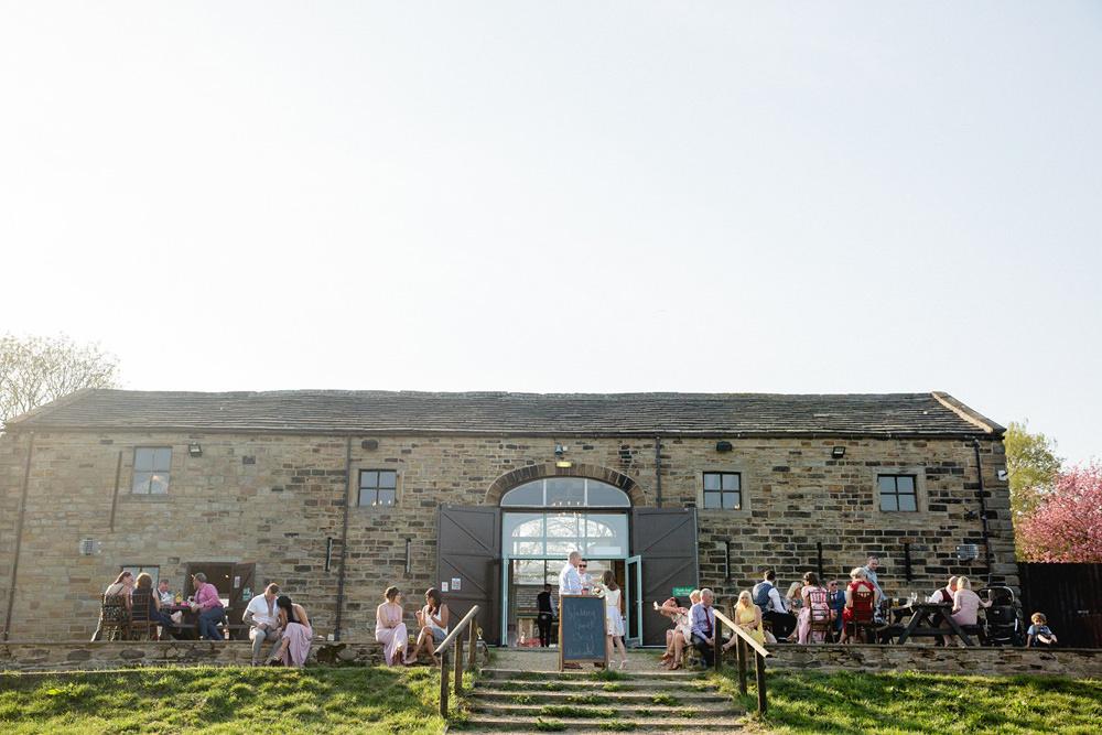 relaxed wedding celebrations outside of oakwell hall barn