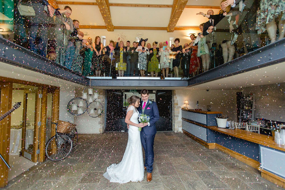 confetti photo at Priory cottages wedding barn