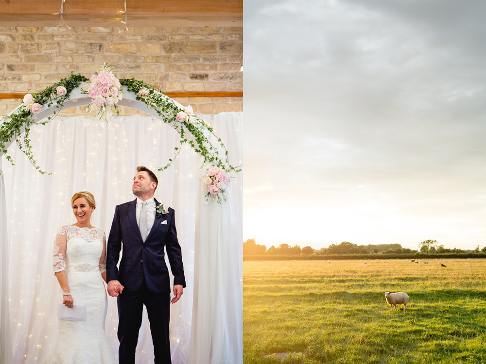 couple in front of flowers arch at Priory cottage wedding barn