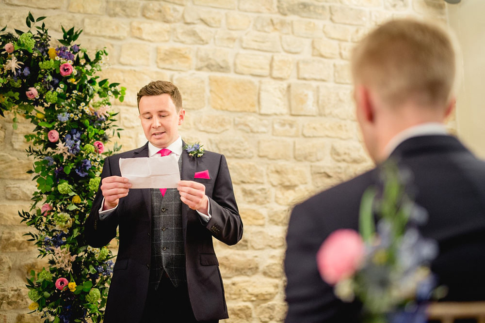 Guests reading during wedding ceremony at priory cottages