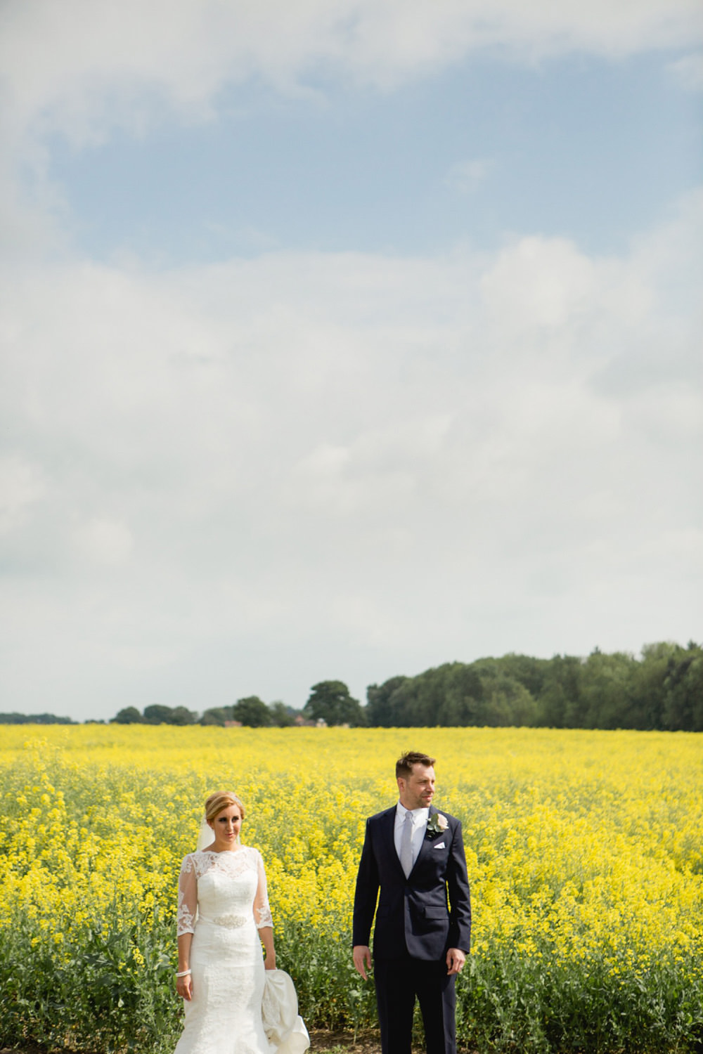 modern wedding photo of couple by fields at priory cottages