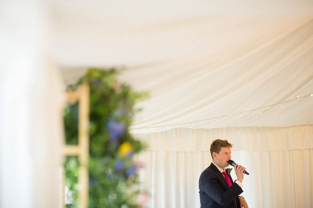 documentary photo of best man reading his speech at Priory cottages
