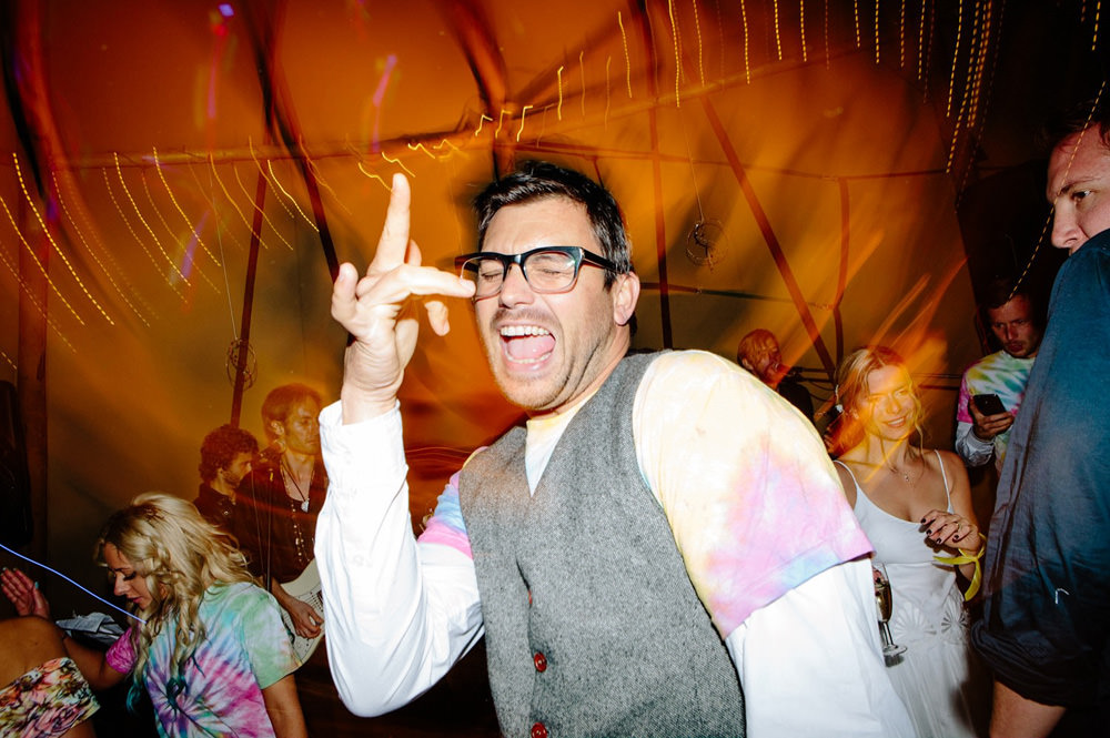 Wedding Guest dancing at talton lodge tipi wedding