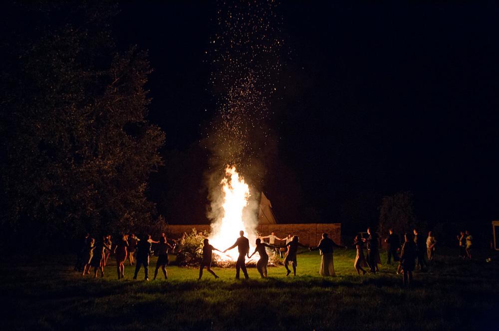 Creative wedding photo of bonfire at talton lodge wedding venue