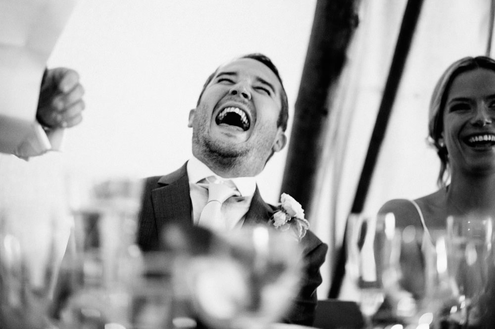 Black and white photo of groom during speech at talton lodge wedding