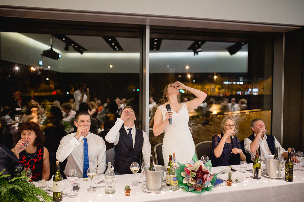 bride finishing speeches with shots at the hepworth wakefield