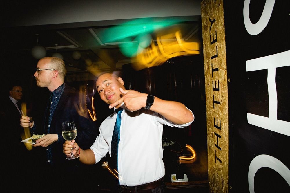fun party pictures while dj plays at the tetley gallery wedding venue leeds