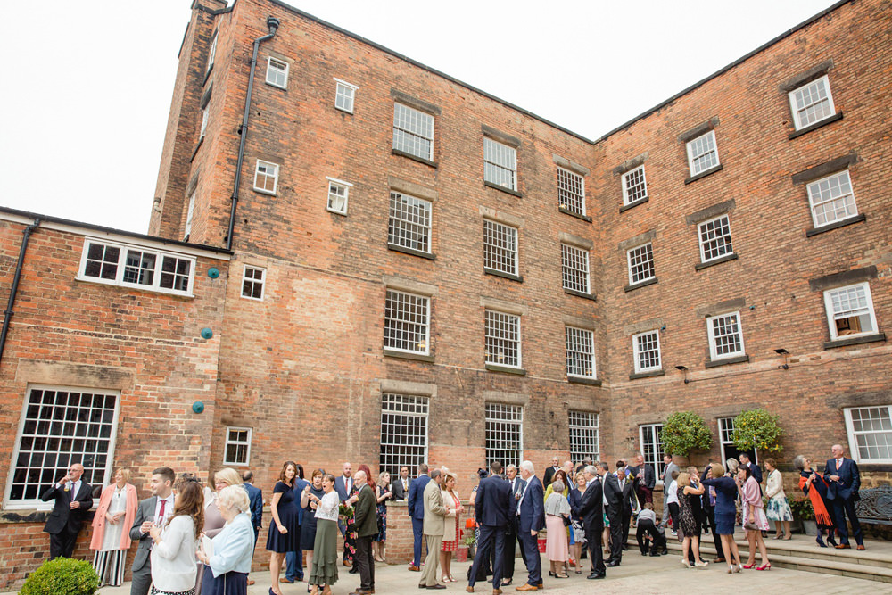 guests in the courtyard at west mill wedding venue derby