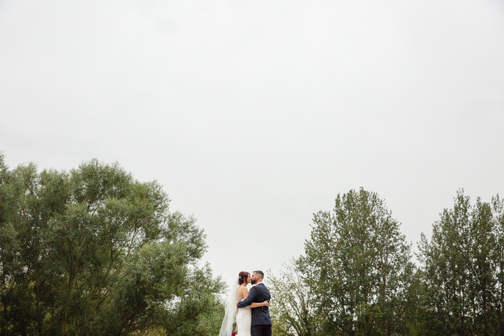 natural wedding portrait outside of mill venue derby