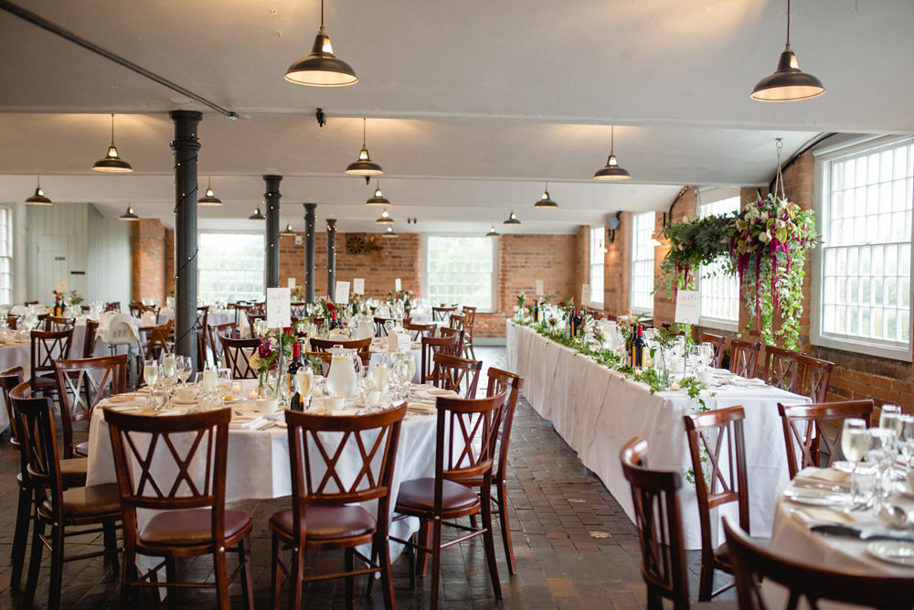 wedding breakfast room at west mill wedding venue