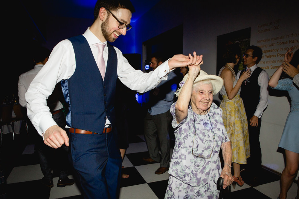 documentary photo of groom dancing to band with grandma at yorkshire sculpture park wedding venue